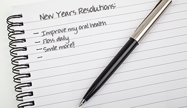 New Years Resolutions written on a note pad.